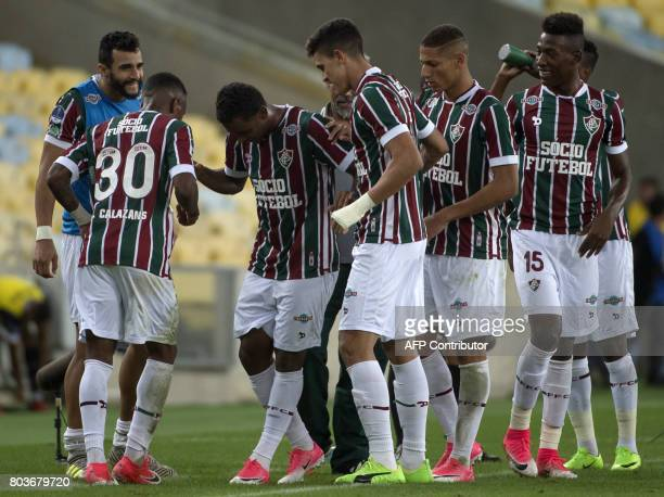 Brazil's Fluminense player Wendel celebrates with his teammates after scoring a goal against Ecuador's Universidad Catolica during their Copa...
