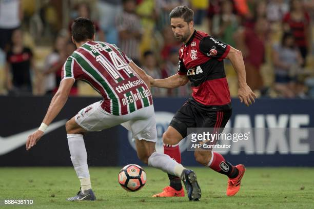 Brazil's Fluminense Reginaldo vies for the ball with Brazil's Flamengo Diego during their 2017 Sudamericana Cup football match against Fluminense at...