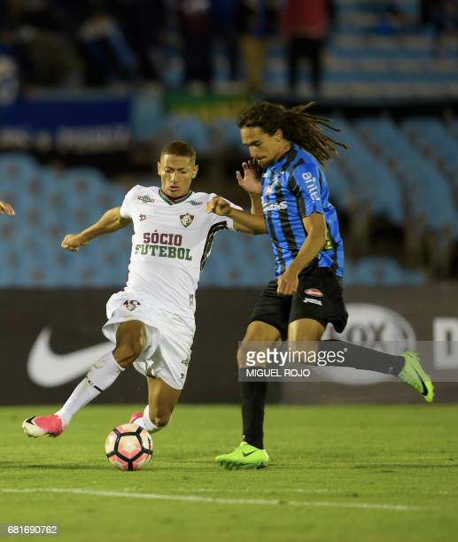 Brazil's Fluminense Richarlison vies for the ball with Uruguay's Liverpool Gustavo Aprile during their Sudamericana Cup football match at the...