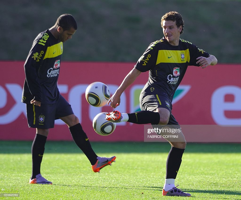 Brazil's football team defender Daniel Alves (L) and midfielder Elano plays with the ball during a team training session at the Randburg High School on June 5, 2010 in Johannesburg. The team is preparing to compete in the 2010 FIFA World Cup in South Africa.