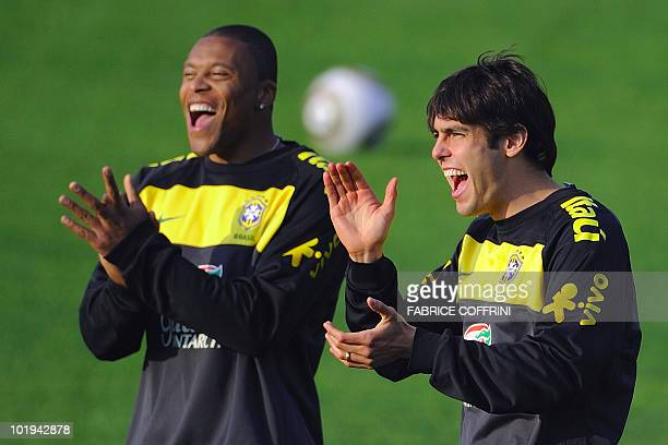 Brazil's football team midfielder Kaka and team mate Julio Baptista applaud during a training session of their team ahead of the FIFA 2010 World Cup...