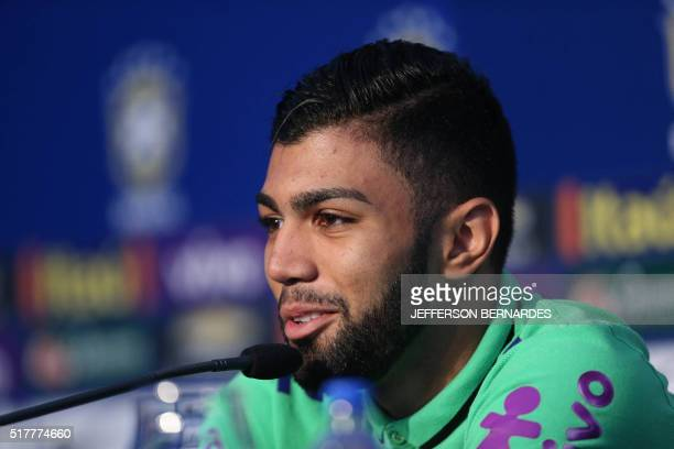 Brazil's football team player Gabriel aka Gabigol speaks during a press conference before a training at their hotel in Viamao Brazil on March 27 2016...