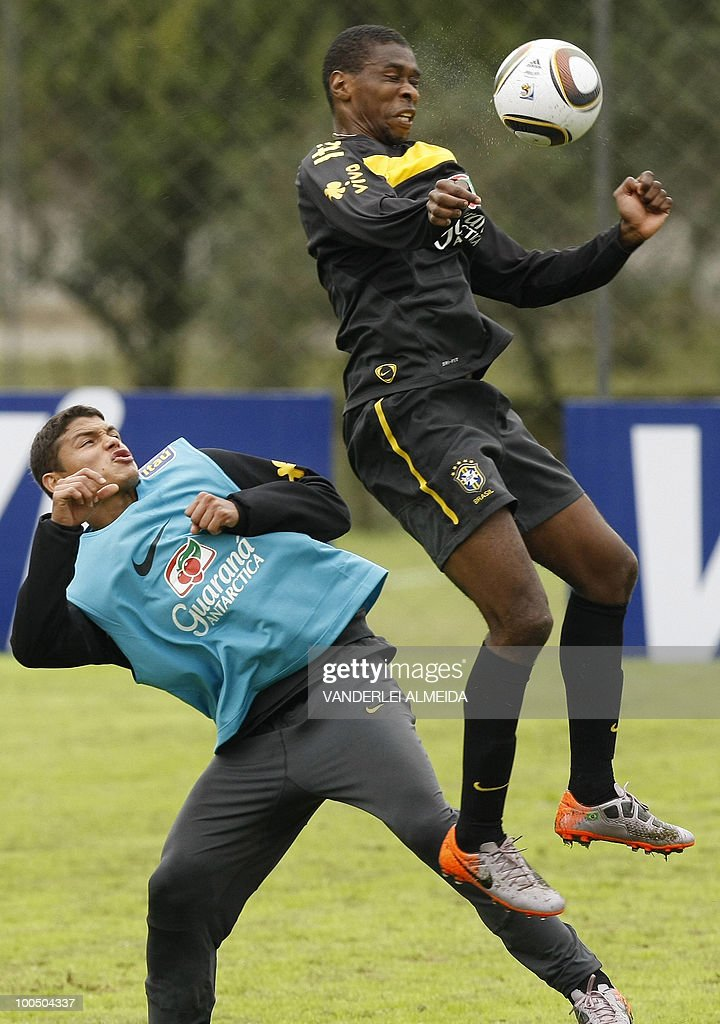 Brazil's football team player Juan (R) vies for the ball with Thiago Silva during a traning session in Curitiba, southern Brazil on May 25, 2010.