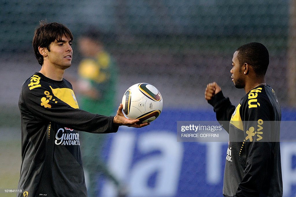 Brazil's football team player Kaka (L) shows a 'Jabulani' football to teammate Robinho during a training session at the Randburg High School on June 5, 2010 in Johannesburg. The team is preparing to compete in the 2010 FIFA World Cup in South Africa.
