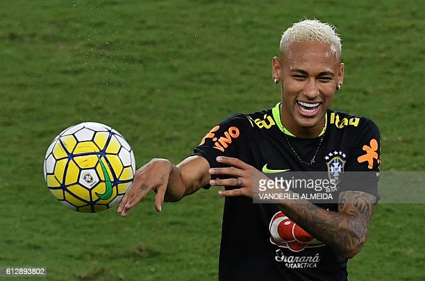 Brazil's football team player Neymar takes part in a training session at the Arena Dunas stadium in Natal Brazil on October 5 2016 on the eve of...