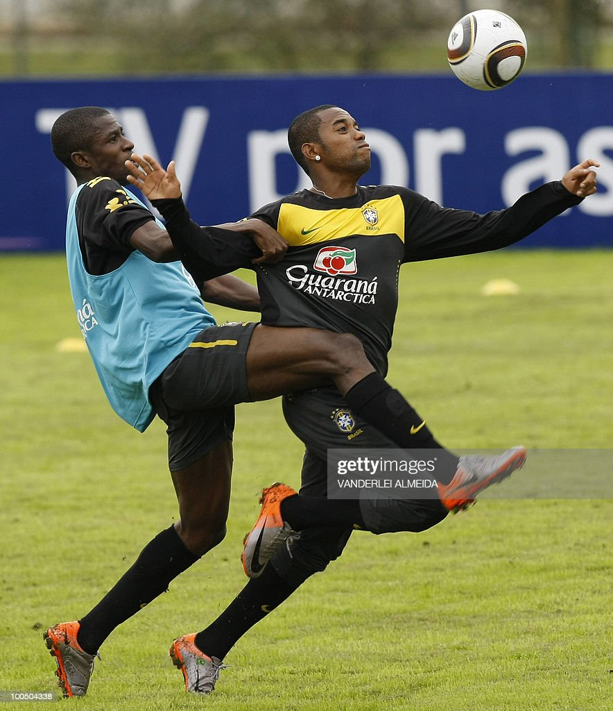 Brazil's football team player Robinho (R) vies for the ball with Ramires during a traning session in Curitiba, southern Brazil on May 25, 2010.