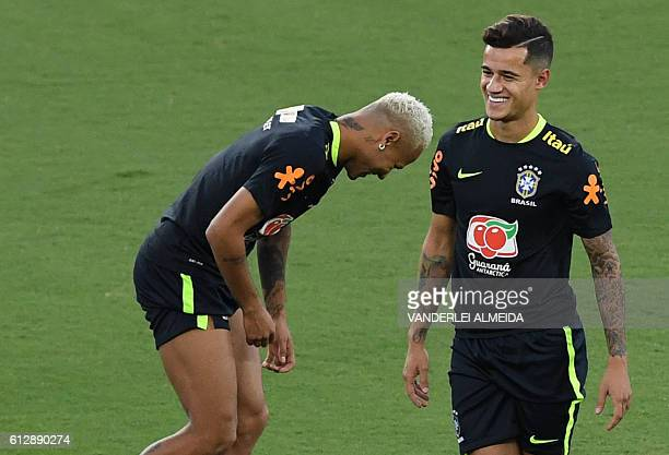 Brazil's football team players Neymar and Philippe Coutinho joke during in a training session at the Arena Dunas stadium in Natal Brazil on October 5...