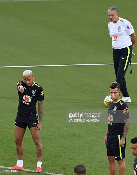 Brazil's football team players Neymar and Philippe Coutinho remain near coach Tite during in a training session at the Arena Dunas stadium in Natal...