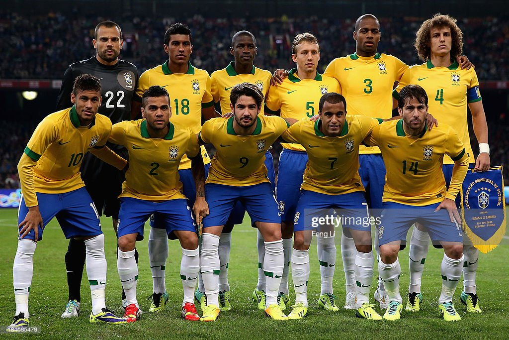 Brazil's football team players (1st row, L-R) Neymar, Daniel, Alexandre, Lucas and <a gi-track='captionPersonalityLinkClicked' href=/galleries/search?phrase=Maxwell+-+Brazilian+Soccer+Player&family=editorial&specificpeople=546154 ng-click='$event.stopPropagation()'>Maxwell</a>, (2nd row, L-R) goalkeeper Diego, Paulinho, Ramires, Lucas, Anderson and David line up before the international friendly match between Brazil and Zambia at Beijing National Stadium on October 15, 2013 in Beijing, China.