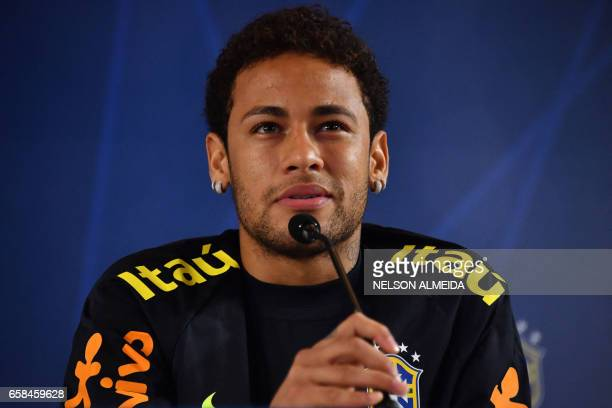 Brazil's footballer Neymar gestures during a press conference after a training session on the eve of their 2018 FIFA Russia World Cup qualifier...