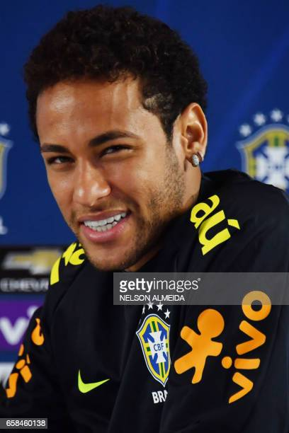 Brazil's footballer Neymar smiles during a press conference after a training session on the eve of their 2018 FIFA Russia World Cup qualifier...