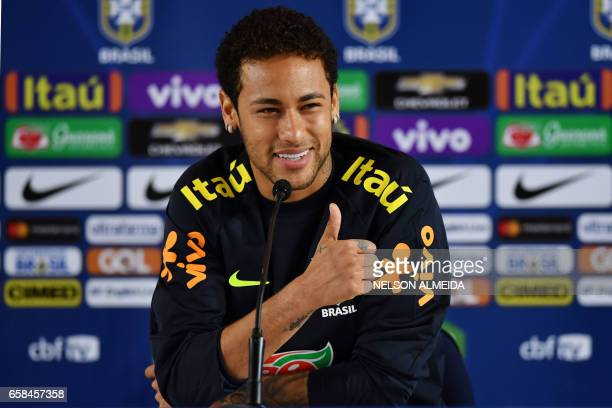 Brazil's footballer Neymar speaks during a press conference after a training session on the eve of their 2018 FIFA Russia World Cup qualifier...