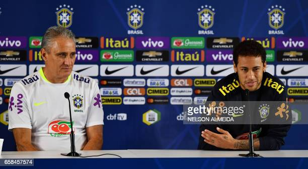 Brazil's footballer Neymar speaks next to team coach Tite during a press conference after a training session on the eve of their 2018 FIFA Russia...