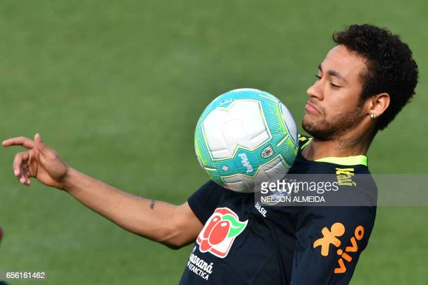 TOPSHOT Brazil's footballer Neymar takes part in a training session at the Corinthians team training centre in Sao Paulo Brazil on March 21 2017...