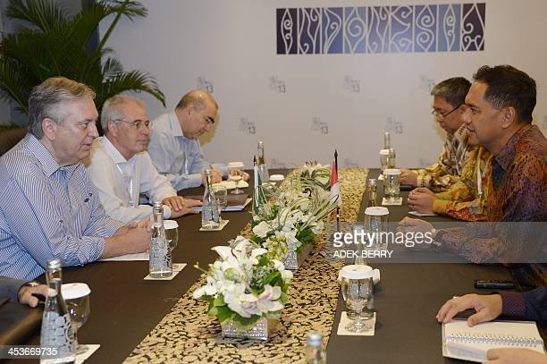 Brazil's Foreign Minister Luiz Alberto Figueiredo talks to Indonesia's Trade Minister Gita Wirjawan during a bilateral meeting on the sideline of the...