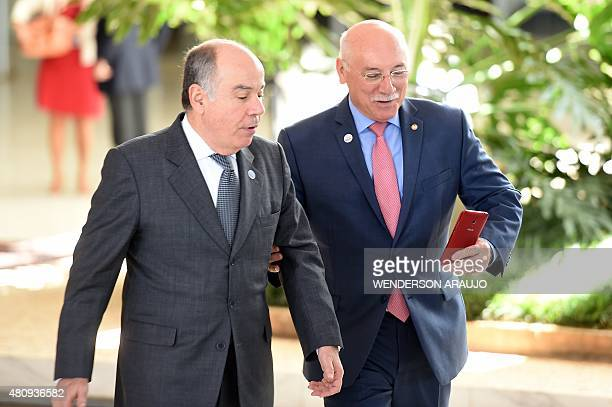 Brazil's Foreign Minister Mauro Vieira and Paraguay's Foreign Minister Eladio Loizaga make a selfie before the family photo of the XLVIII Meeting of...