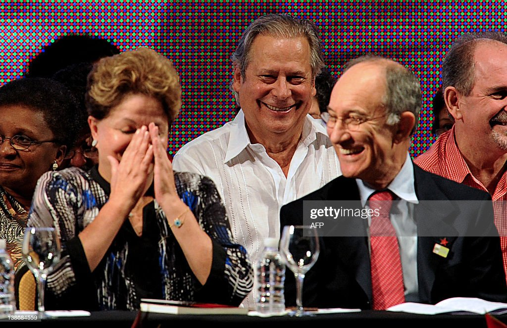 Brazil's former Chief of Staff Jose Dirceu looks at President Dilma Rousseff and PT President Rui Falcao during the celebration of the 32nd...