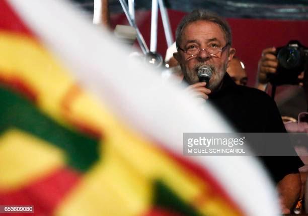 Brazil's former President Luiz Inacio Lula da Silva delivers a speech as he takes part in a protest during a national strike against the government's...