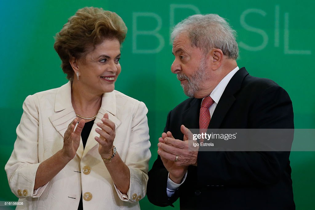 Brazil's former president, Luiz Inacio Lula da Silva (R), is sworn in as the new chief of staff for embattled President <a gi-track='captionPersonalityLinkClicked' href=/galleries/search?phrase=Dilma+Rousseff&family=editorial&specificpeople=1955968 ng-click='$event.stopPropagation()'>Dilma Rousseff</a> on March 17, 2016 in Brasilia, Brazil. His controversial cabinet appointment comes in the wake of a massive corruption scandal and economic recession in Brazil.