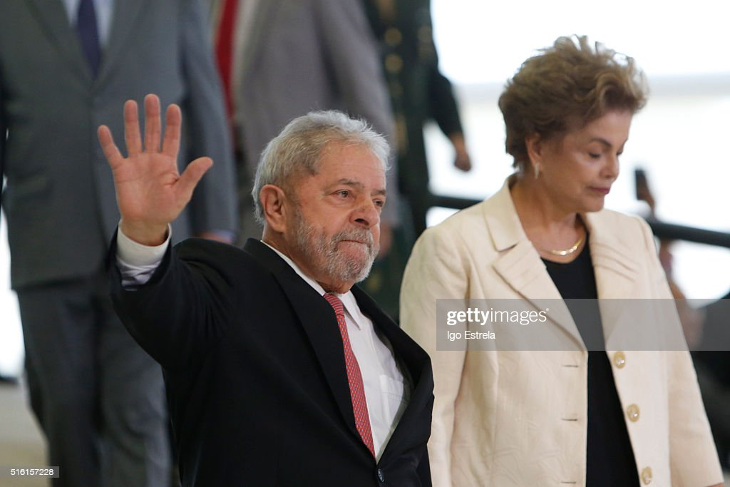 Brazil's former president, Luiz Inacio Lula da Silva (L) walks with President Dilma Rousseff as he is sworn in as the new chief of staff in the Planalto Palace on March 17, 2016 in Brasilia, Brazil. His controversial cabinet appointment comes in the wake of a massive corruption scandal and economic recession in Brazil.