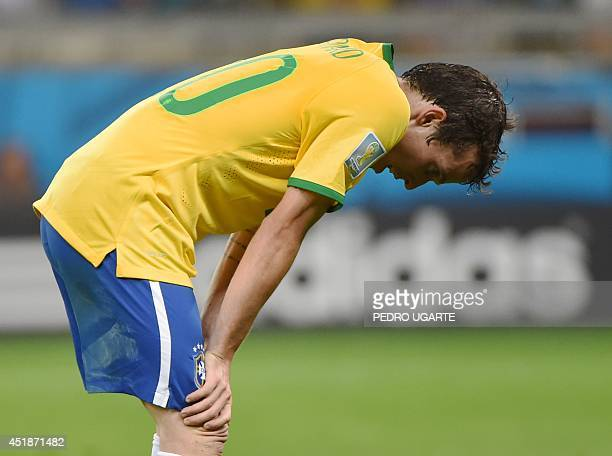 Brazil's forward Bernard reacts after the semifinal football match between Brazil and Germany at The Mineirao Stadium in Belo Horizonte during the...