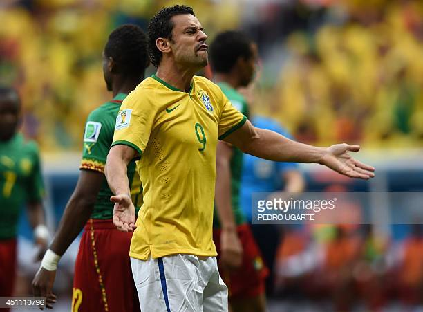 Brazil's forward Fred gestures during a Group A football match between Cameroon and Brazil at the Mane Garrincha National Stadium in Brasilia during...