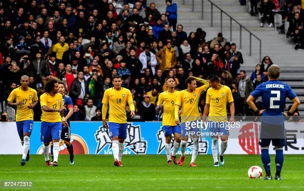 Brazil's forward Gabriel Jesus celebrates with teammates after scoring a goal during Japan's friendly football match against Brazil on November 10...