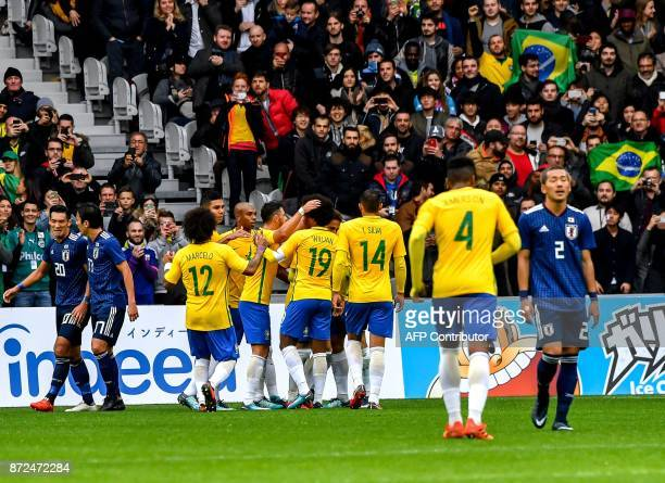 Brazil's forward Gabriel Jesus is congratuled by his teammates after scoring a goal during Japan's friendly football match against Brazil on November...