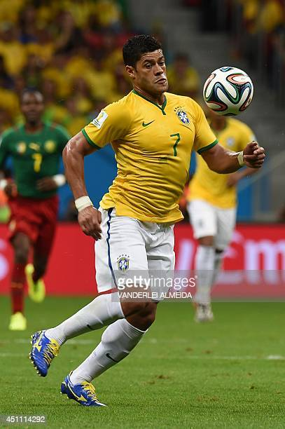 Brazil's forward Hulk dribbles the ball during the Group A football match between Cameroon and Brazil at the Mane Garrincha National Stadium in...