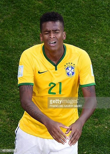 Brazil's forward Jo reacts during the round of 16 football match between Brazil and Chile at The Mineirao Stadium in Belo Horizonte during the 2014...