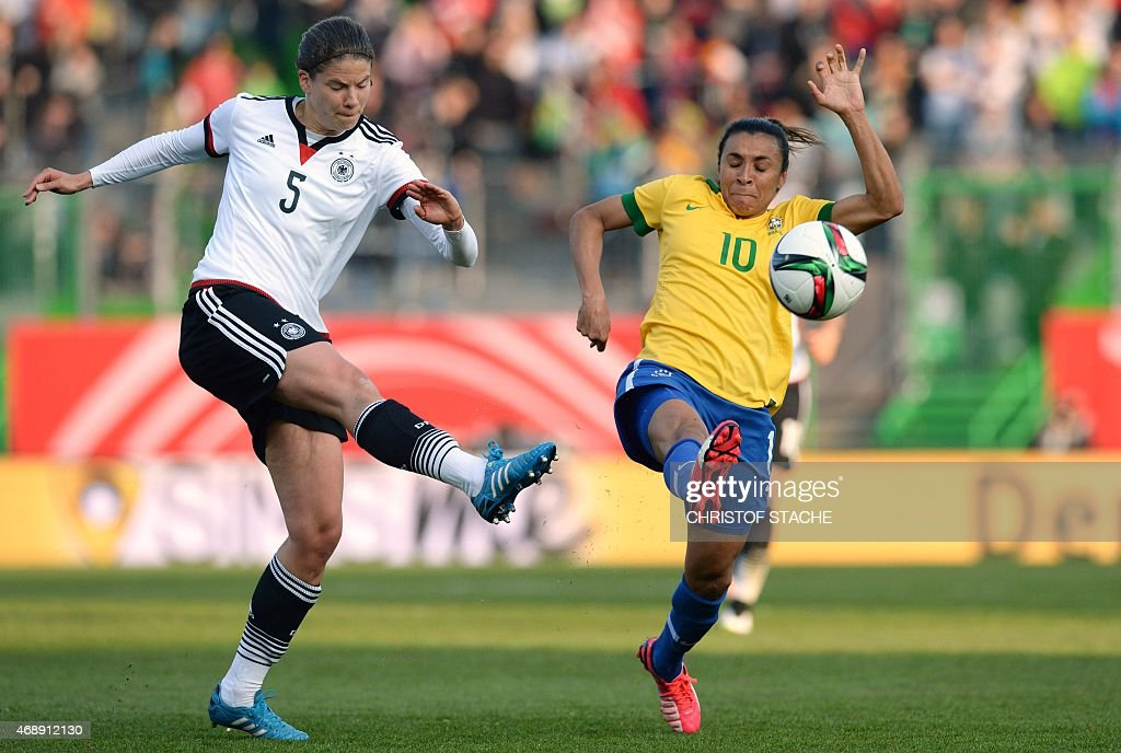 Brazil's forward <a gi-track='captionPersonalityLinkClicked' href=/galleries/search?phrase=Marta+-+Soccer+Player&family=editorial&specificpeople=3038337 ng-click='$event.stopPropagation()'>Marta</a> (R) and Germany's defender <a gi-track='captionPersonalityLinkClicked' href=/galleries/search?phrase=Annike+Krahn&family=editorial&specificpeople=808044 ng-click='$event.stopPropagation()'>Annike Krahn</a> (L) vie for the ball during the friendly women football match between Germany and Brazil in the stadium in Fuerth, southern Germany, on April 8, 2015.