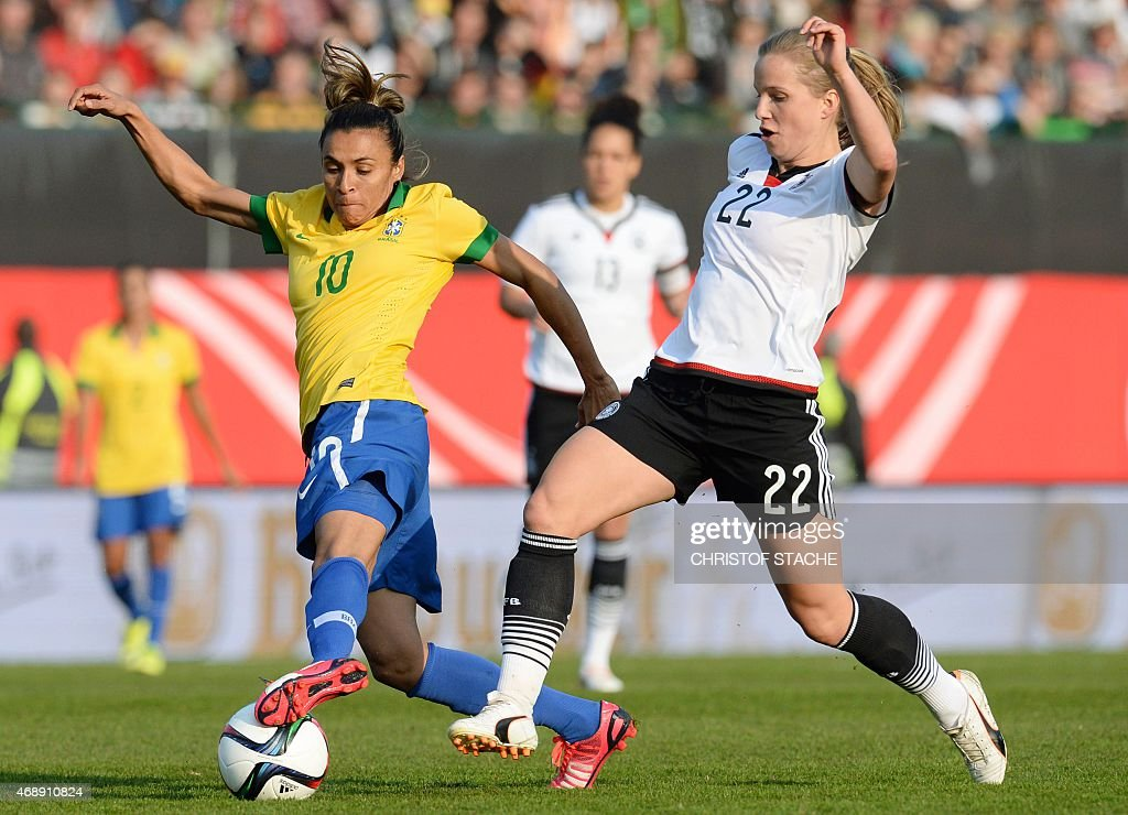 Brazil's forward <a gi-track='captionPersonalityLinkClicked' href=/galleries/search?phrase=Marta+-+Soccer+Player&family=editorial&specificpeople=3038337 ng-click='$event.stopPropagation()'>Marta</a> (L) and Germany's defender <a gi-track='captionPersonalityLinkClicked' href=/galleries/search?phrase=Tabea+Kemme&family=editorial&specificpeople=4334797 ng-click='$event.stopPropagation()'>Tabea Kemme</a> vie for the ball during the friendly women football match between Germany and Brazil in the stadium in Fuerth, southern Germany, on April 8, 2015.