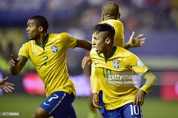 Brazil's forward Neymar and Brazil's midfielder Douglas Costa after scoring against Peru during their 2015 Copa America football championship match...
