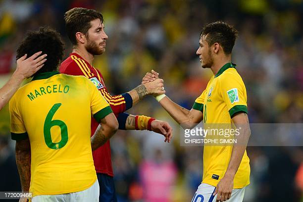 Brazil's forward Neymar and Spain's defender Sergio Ramos greet each other at the end of their FIFA Confederations Cup Brazil 2013 final football...