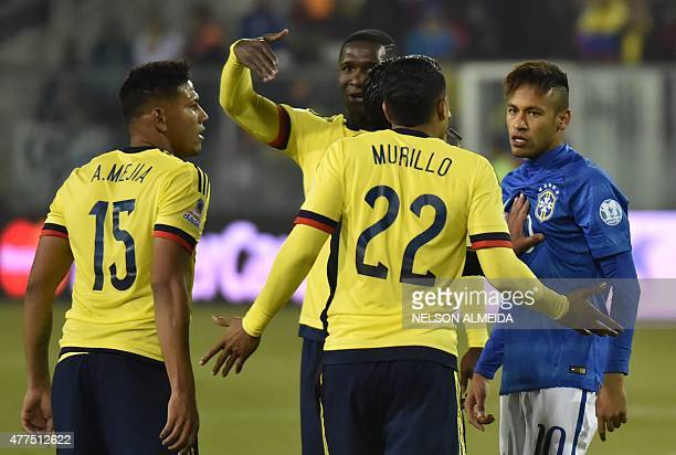 Brazil's forward Neymar argues with Colombians Jeison Murillo and Alexander Mejia among others during a 2015 Copa America football championship match...