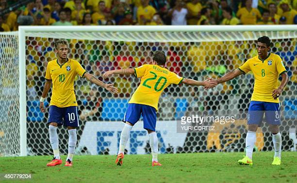 Brazil's forward Neymar Brazil's forward Bernard and Brazil's midfielder Paulinho react after a Group A football match between Brazil and Mexico in...