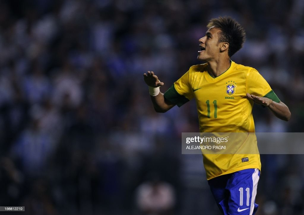 Brazil's forward Neymar celebrates after scored the last penalty kick during the Americas' Super Derby football match at La Bombonera stadium in Buenos Aires on November 21, 2012. Brazil defeating Argentina in penalty shoot-out 4-3.