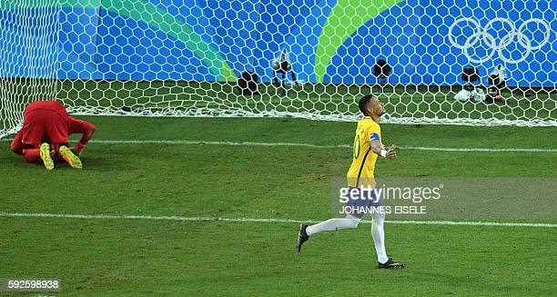 Brazil's forward Neymar celebrates scoring the winning goal during the penalty shootout of the Rio 2016 Olympic Games men's football gold medal match...