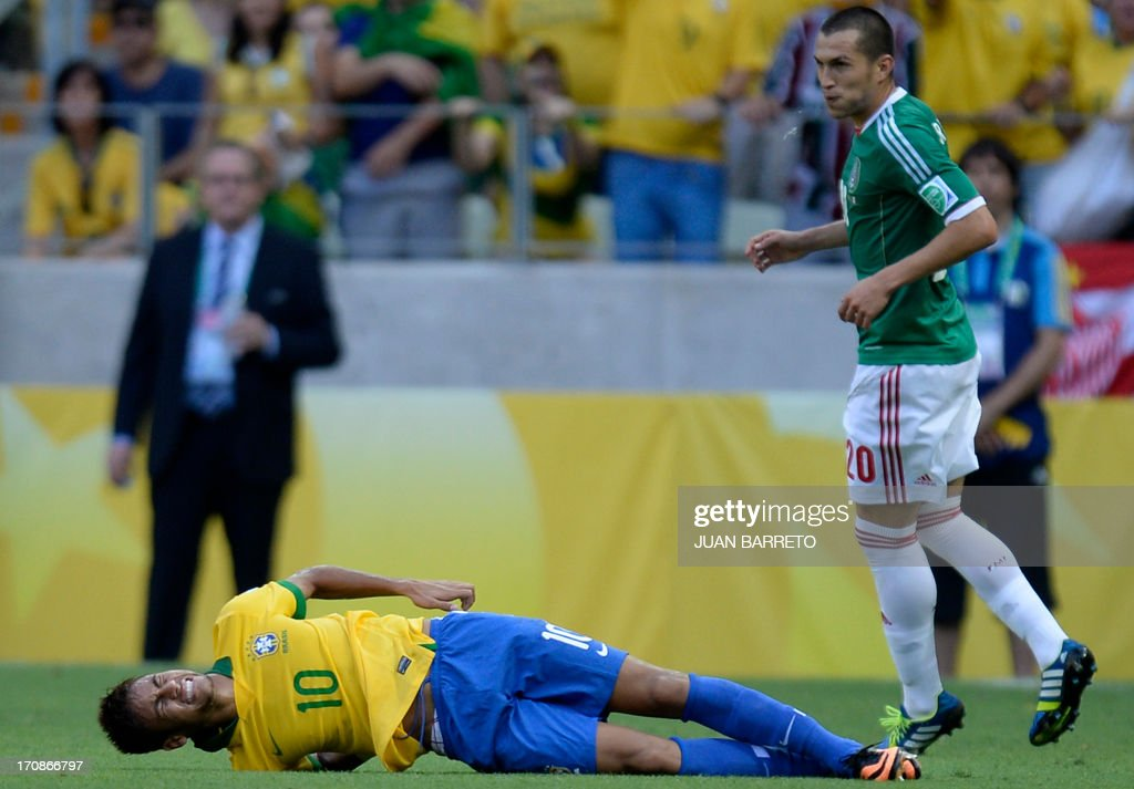 Brazil's forward Neymar gestures on the ground after Mexico's defender Jorge Torres stepped on the side of his back, during their FIFA Confederations Cup Brazil 2013 Group A football match, at the Castelao Stadium in Fortaleza, on June 19, 2013.
