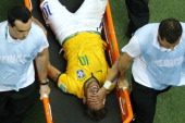 Brazil's forward Neymar is carried off the pitch on a stretcher after being injured during the quarterfinal football match between Brazil and...