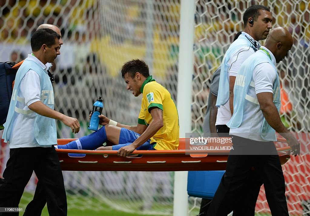 Brazil's forward Neymar is carried on a stretcher during their FIFA Confederations Cup Brazil 2013 Group A football match against Japan, at the National Stadium in Brasilia on June 15, 2013.