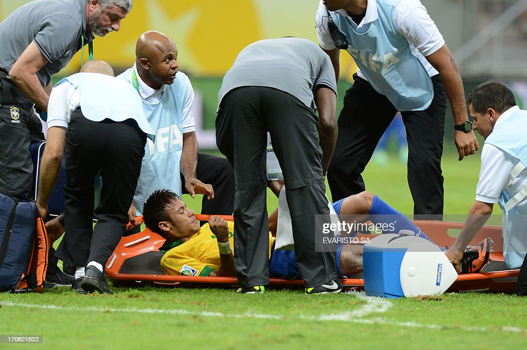 Brazil's forward Neymar is carried onto a stretcher during their FIFA Confederations Cup Brazil 2013 Group A football match against Japan, at the National Stadium in Brasilia on June 15, 2013. AFP PHOTO / EVARISTO SA