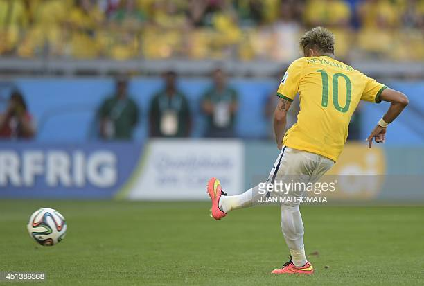 Brazil's forward Neymar kicks the ball during the penalty shoot out after extratime in the Round of 16 football match between Brazil and Chile at The...