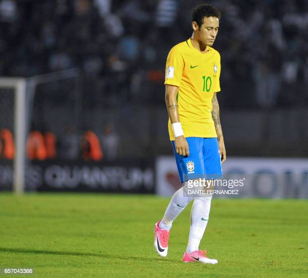 Brazil's forward Neymar leaves the field at halftime during their 2018 FIFA World Cup qualifier football match against Uruguay at the Centenario...