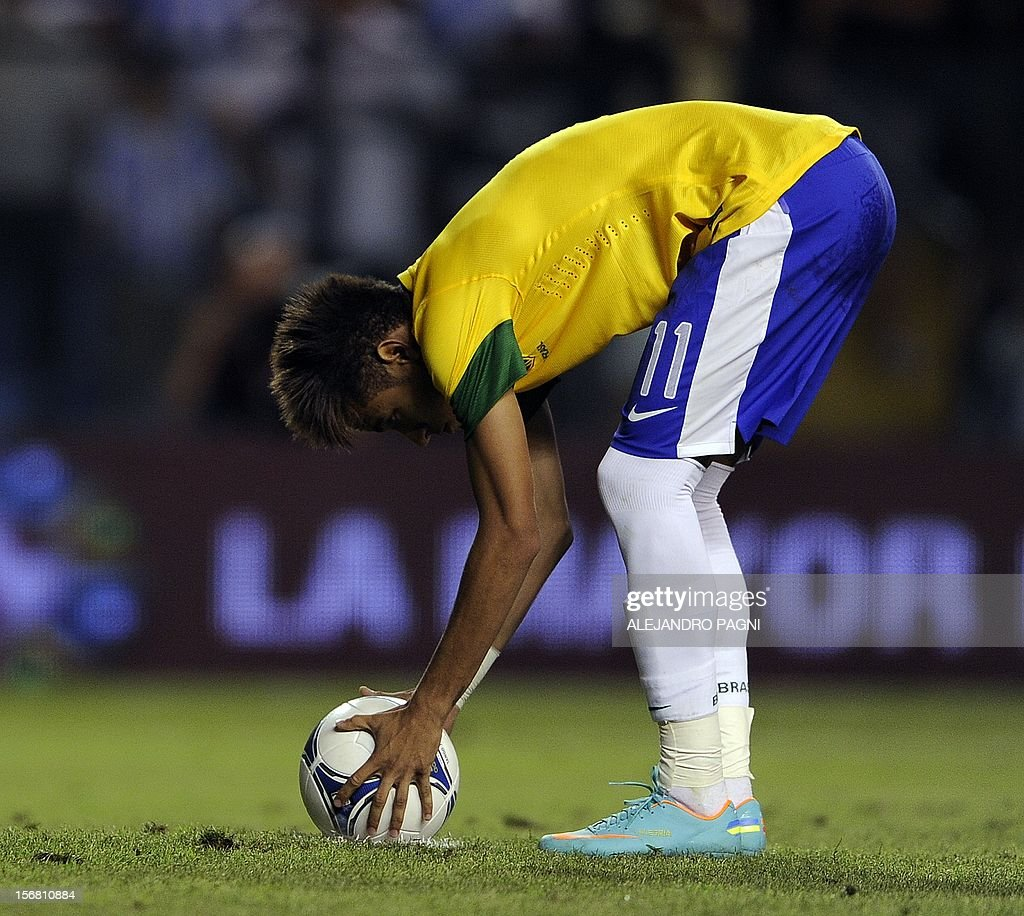 Brazil's forward Neymar prepares the ball before shoot a penalty kick against Argentina during the Americas' Super Derby football match at La Bombonera stadium in Buenos Aires on November 21, 2012. Argentina won 2-1 but in penalty definition Brazil scored 4-3.