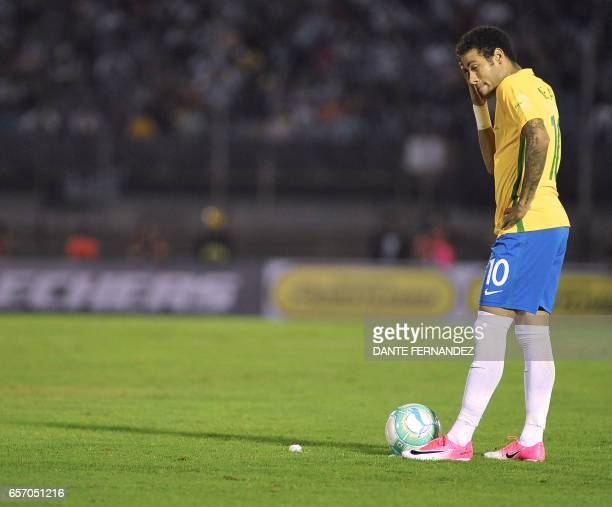 Brazil's forward Neymar prepares to shoot during their 2018 FIFA World Cup qualifier football match against Uruguay in the Centenario stadium in...