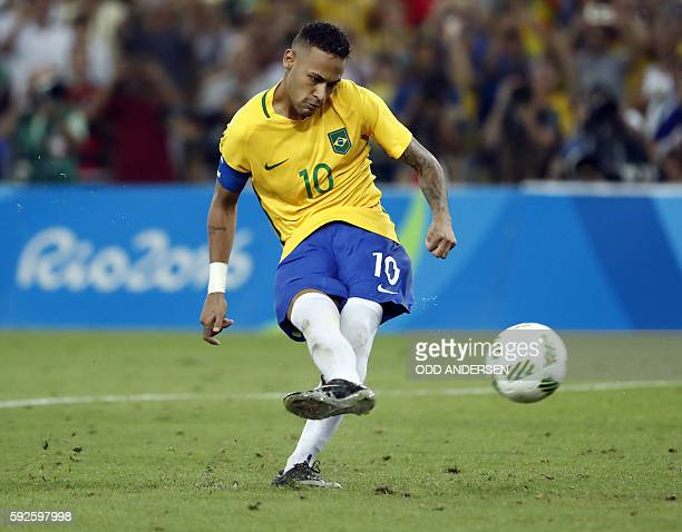 Brazil's forward Neymar scores the winning goal during the penalty shootout of the Rio 2016 Olympic Games men's football gold medal match between...