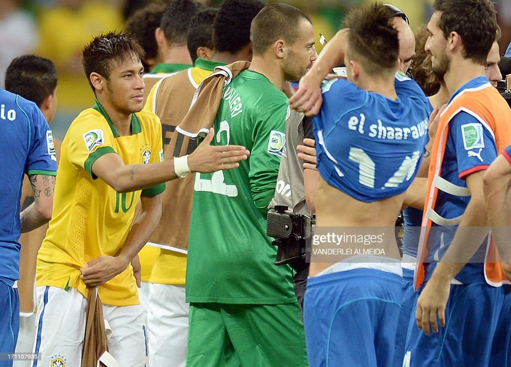 Brazil's forward Neymar (L) shakes hands with an Italian player before exchanging jerseys with Italy's forward Stephan El Shaarawy (2-R) at the end of their FIFA Confederations Cup Brazil 2013 Group A football match, at the Fonte Nova Arena in Salvador, on June 22, 2013. Brazil won 4-2.