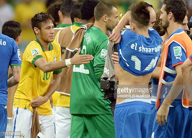 Brazil's forward Neymar shakes hands with an Italian player before exchanging jerseys with Italy's forward Stephan El Shaarawy at the end of their...