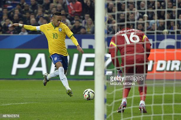 Brazil's forward Neymar strikes on his way to score a goal during the friendly football match France vs Brazil on March 26 2015 at the Stade de...
